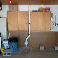 Custom radon mitigation system through attached garage